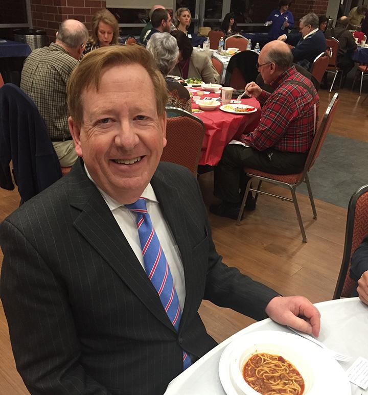 Carmel Mayor Jim Brainard enjoys a bowl of chili at the Carmel Clay Republican Club's Chili Supper. (photo by Adam Aasen)