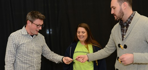 Right, Jason Riley of Market District presents CHS choir teacher John Burlace, left, with a gift card for being named Teacher of the Month as Haley Urbanowski, the student who nominated Burlace, looks on. (Photo by Theresa Skutt)