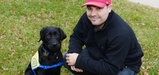 Brett Lemieux has been caring for a black Labrador named Kaya through Canine Companions for Independence since the puppy was three months old. (Photo by Theresa Skutt)