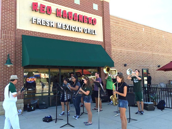 Band students have performed on street corners in the past to acquire attention to the music programs offered at WHS. (Submitted photo)