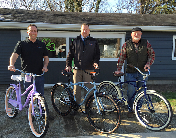 From left, Curt Whitesell, Tim Retzinger  and Bob Beauchamp display the Wander Westfield bikes outside of the Union. (Photo by Anna Skinner)