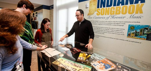Julia Shildmyer-Heighway, Leslie Hoggat, Becky Lee Macy, and Chris Lewis, Director of Programs for the Songbook Foundation, look at artifacts along the main wall of the exhibit. (Submitted photos)