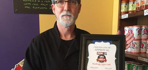 Roy LeBlanc holds the award given to Mudbugs Cajun Café from Fox59. (Photo by Anna Skinner)