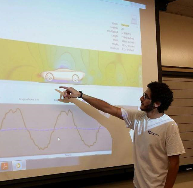 Ghassan Zalem explains aerodynamic principals and results from a wind tunnel simulation. (Submitted photo)