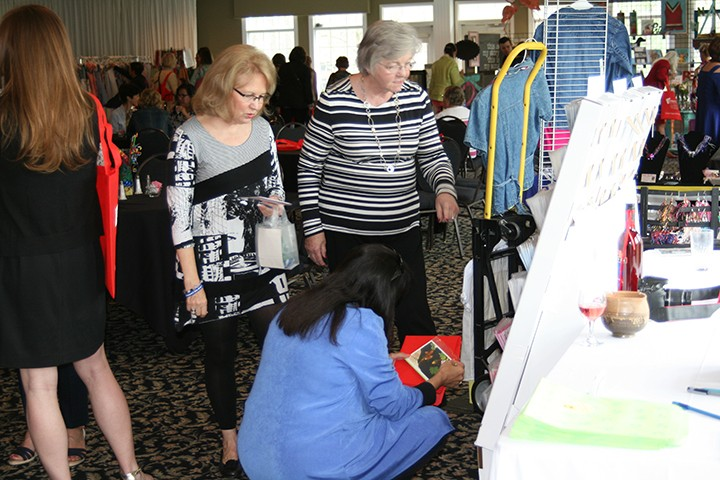 Guests browse work from local independent artists during Art in the Afternoon. (Submitted photo)