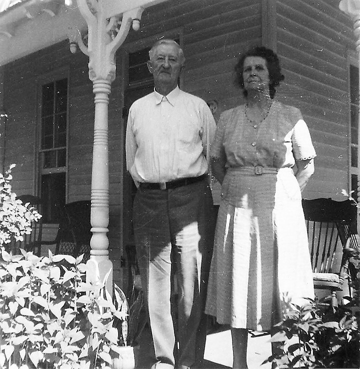 Fred and Rose Graves stand on the front porch of their house in 1957, which is now the site of Bub's Burgers and Ice Cream on Main Street. (Submitted photo)