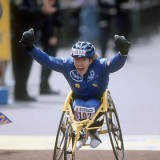 Jean Driscoll crosses the finish line at the Boston Marathon in 2000. (Photo by Boston Athletic Association)