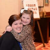 Kelsey Leichtnam gets a hug from Isabella Holden, 8, who received a Disney trip through the Make-a-Wish Foundation. (Photo by Theresa Skutt)