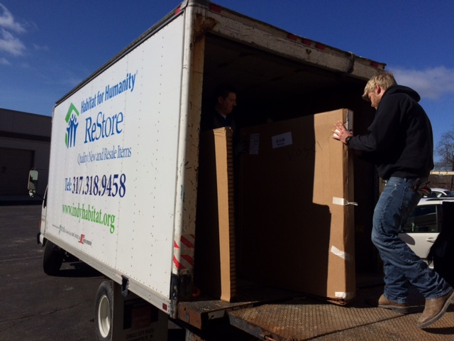 Kyle Morrison of Renewal by Anderson in Carmel unloads a delivery for a ReStore project. (Submitted photo)