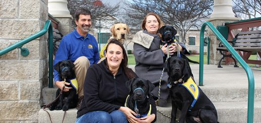 From top left, Fishers resident Dave Norris with his two dogs Hakuna (black Lab) and Hissou (yellow Lab), Fishers resident Nancee Wright with her two dogs Hollister (small black Lab) and Ernest and Emily Hansen with her dog Halston. (Photo by James Feichtner)