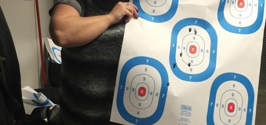 Erin Shockley proudly displays her target.