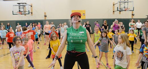 Fishers nurse and exercise instructor Robanne Robin leads a youth fitness hip hop dance class with area Girl Scouts March 25 at the Fishers YMCA. (Photo by Theresa Skutt)