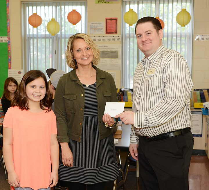 From left, Sophie Reed, Aleks Johnson and Dan Mixan of Market District at the Teacher of the Month party. (Photo by Theresa Skutt)