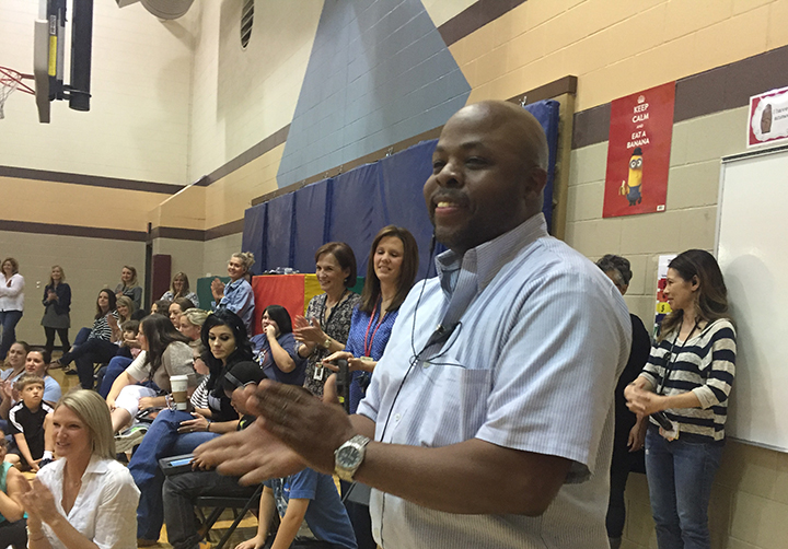 College Wood Elementary students and staff members honor head custodian Morris Eubank on May 6 at a special ceremony. (Photo by Adam Aasen)