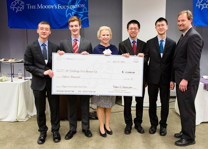 Moody's Foundation President Fran Laserson, center, presents a $15,000 college scholarship to runners up, from left, Simon Langowski, Joseph Philleo, Miles Dai and Tiger Huang of Carmel High School along with coach Peter Beck. (Submitted photo)