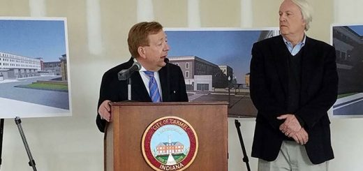 Carmel Mayor Jim Brainard speaks at the groundbreaking for the new parking garage as Pedcor co-chariman/founder Bruce Cordingley looks on. (Submitted photo)