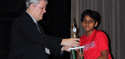 Abhinay Mundrigi accepts a trophy at the National Elementary Chess Championship. (Submitted photo)