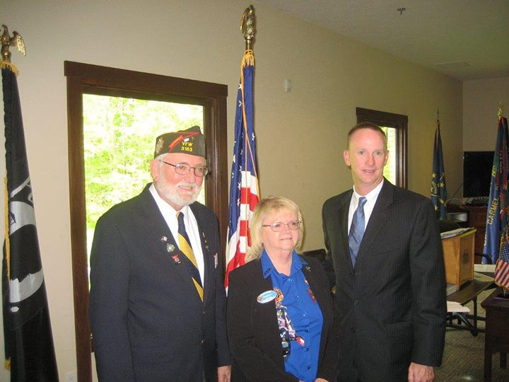 VFW Indiana State Commander Buzz Weberding, left, and Sharron Barger, VFW Auxiliary president for the state of Indiana, recognize Carmel High School teacher Will Ellery. (Photo by Ray Compton)