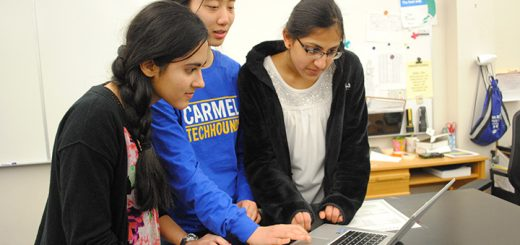From left, Kimaya Raje, Jackie Hu and Gayatri Balasubramanian work on coding at the Carmel Girls Can Code Club. (Photo by Anna Skinner)