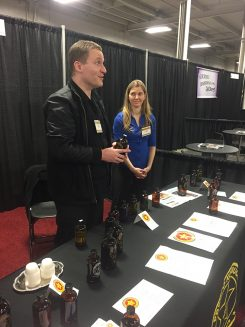 Nick Murdick, left, speaks to customers about his kombucha teas. (Submitted photos)