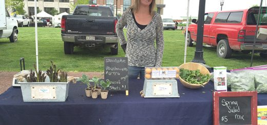 From 8:30 to 11:30 a.m. May 7, market shoppers braved the intermittent rain to shop the booths at the Carmel Farmers Market. Pictured here is Sara Creech, who works a booth for Blue Yonder Organic Farm. (Photos by Anna Skinner)