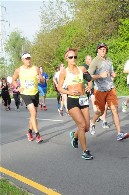Elizabeth Bradshaw, diagnosed with MS in May of 2015, runs in the 2016 500 Festival Mini Marathon. (Submitted photo)