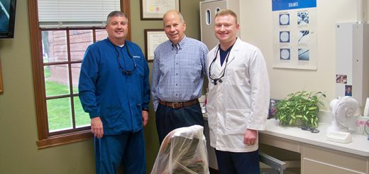 Dr. William Sauter (center), pictured with fellow dentists Dr. Gregory Ryan (left) and Dr. Scott Bassett (right), founded Fishers Family Dentistry in 1986. (Photo by Sam Elliott)