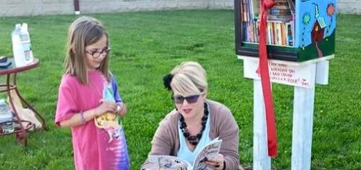 Esther Mead, right, introduces her first Itty Bitty Library to Dani Ginder. (Submitted photo)