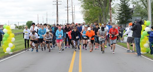Runners take off at the start of the inaugural race. (Photo by Theresa Skutt)