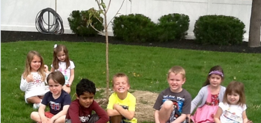 From left, Lilliana Elson, Presley Roberson, Jacob Young, Aditya Changalva, J. Cash Lyons, Hunter Cathelyn, Reese Ramsey and Grace Hammer, students at The Goddard School in Carmel, surround a tree planted during Root for Earth week. (Submitted photo)