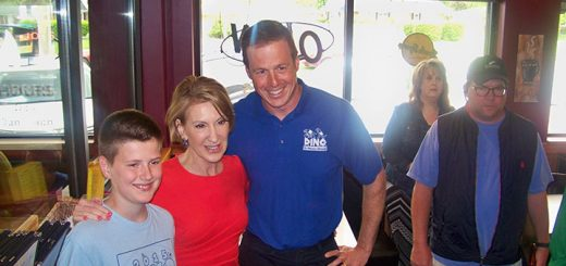Local voter Brian Holzhausen and his son, Hans, pose for a photo with Republican Vice President candidate Carly Fiorina May 2 in Fortville.