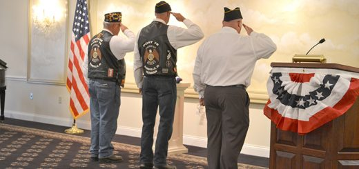 """Zionsville American Legion Post 79 members perform flag folding as """"Taps"""" is played during the 2015 program. (Submitted photo)"""