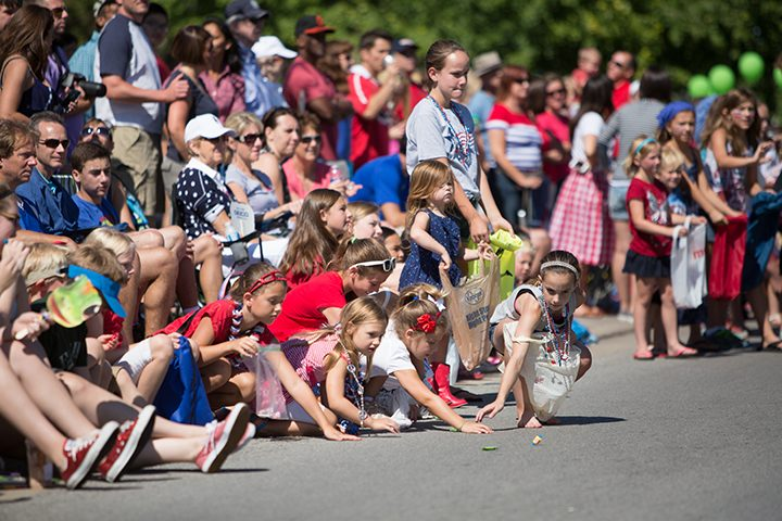 Children collect candy during last year's CarmelFest parade. (Submitted photo.)