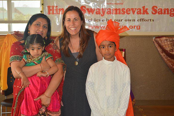 Geeta Ganthi holds Akshara Purumundla alongside Prairie Trace Elementary schoolteacher Heather Monger and student Akshay Purumundla. (Submitted photo)