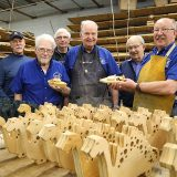 "From left, ""Kaz"" Kazakevich, Bob Lawrence, Charlie Johnson, Gary Reeder, Fred Koberna and Rallie Murphy are among the members of the Carmel Kiwanis Golden K Club who volunteer in its woodworking shop. (Photo by Ann Marie Shambaugh)"