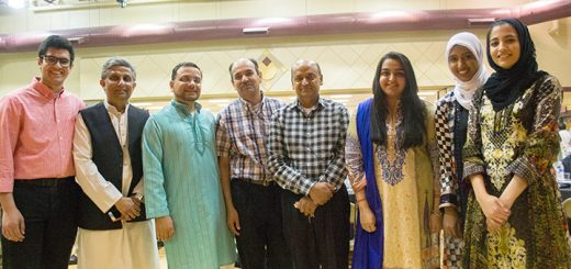 From left, Zaid Saeed, Waqar Qazi, Ashhar Madni, Ashraf Saeed, Khalid Mahmood, Huda Mahmood, Afra Hussain and Hera Ashraf arrange themselves while facing a stage. Madni is the vice president of the Al Salam Foundation.