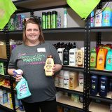 Christina Huffines displays products stored in the Dotted Line Divas personal care pantry. (Photo by Ann Marie Shambaugh)