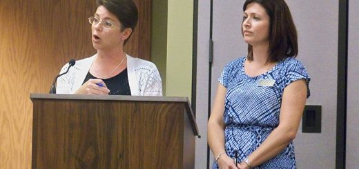 Hamilton Southeastern Schools Business Manager Cecilie Nunn, left, and Food Services Director Andrea Ray address the school board during its May 25 meeting. (Photo by Sam Elliott)