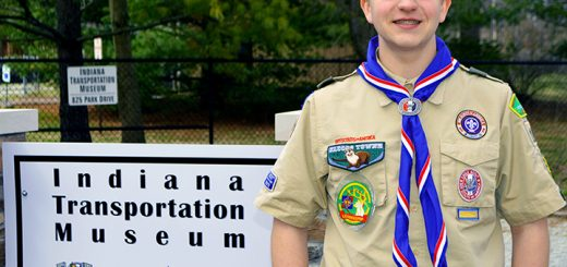 Fishers Troop 109 Boy Scout Nicholas Baehl shows off the new sign he designed and installed outside the Indiana Transportation Museum. (Submitted photo)