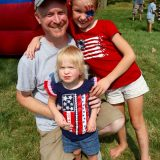 Joseph Kintzel, and daughters Lauren and Sadie, right, enjoy the Kids Area at last year's Westfield Rocks the 4th. (File photo by Sadie Hunter)