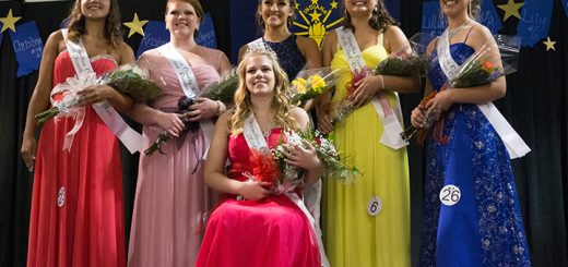 Katie Goodyear, Fishers, Megan Wiley, Fishers, Chloe Mills, Cicero, Lily Arnold, Noblesville, and Jaci Zook, Noblesville stand behind Rachel Adams, Sheridan, as photos are taken of the group. Goodyear, Wiley, Mills, Arnold and Zook made up Adams' court.