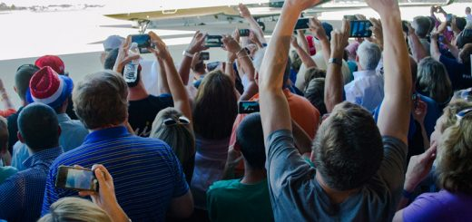 Members of the crowd take photos of Mike Pence's airplane. Mike Pence delivered his speech as soon as he stepped off of his airplane.