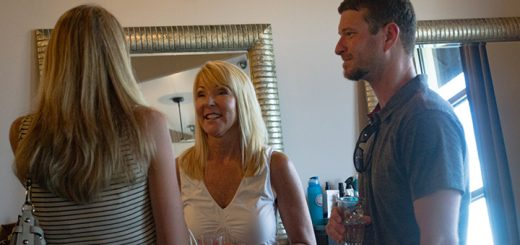From left, Maren Sheese, owner Kim McDaniel and Nick Sheese converse near the workstations of hairstylists.
