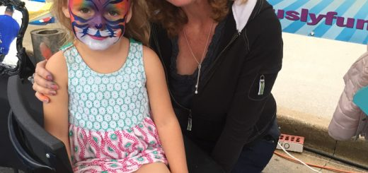 Arya Frizzell gets her face painted by Adrienne Maynard of Fabulously Fun Company. (Photo by Anna Skinner)