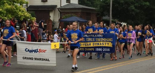 The Carmel High School girls swimming team served as the Grand Marshal due to its 30-year dynasty state championship. (Photo by Anna Skinner)
