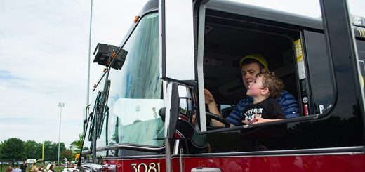 William Graff holds Josh Graff in a fire truck.