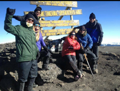 From left, Chris Wallace of Indianapolis, Olivia Anderson of Atlanta, Ga., Angela Griffith of Atlanta, Andrea Ryan of Carmel, Bill Ryan of Carmel and Brian Debshaw of Zionsville at the summit of Mount Kilimanjaro, 12 degrees outside (Submitted photo)