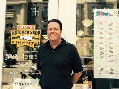 Joe Lazzara outside Joe's Butcher Shop and Fish Market. (Photo by Mark Ambrogi)