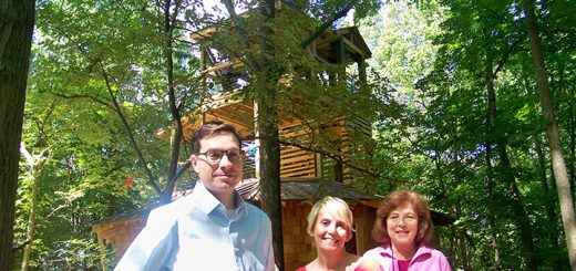 From left, Conner Prairie's Director of Exhibits Brian Mancuso, VP and COO Cathy Ferree and Exhibit Developer Cathy Donnelly show off the four-story tree house at Treetop Outpost. (Photo by Sam Elliott)