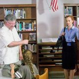 """Fishers director Joe Crump talks with actresses Samantha Colburn and Brooklyn Rae Silzer between takes of """"The Storyteller"""" during shooting at Hamilton Southeastern High School. (Photos by Sam Elliott)"""